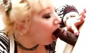 Big titted mature sucks and fucks in gloryhole
