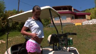 Horny bitch Victoria Sweet fingers herself right on a golf lawn